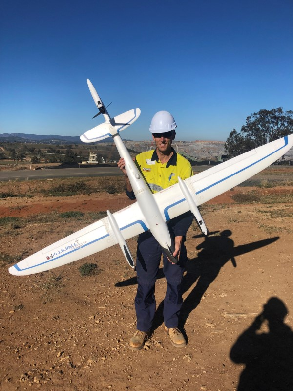 Surveyor using the Trinity F9 survey drone from Position Partners
